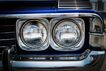 Headlight of a vintage car.