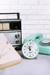 canvas print picture - Retro composition with old phone, radio, clock and books, close