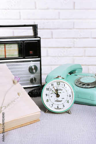 canvas print picture Retro composition with old phone, radio, clock and books, close