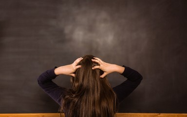 Confused pupil looking at chalkboard