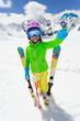 Ski, winter fun - lovely skier girl enjoying ski vacation