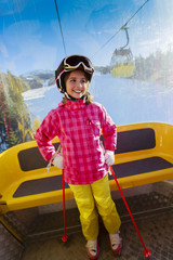 Ski, ski cable car, skier - happy girl in cable car