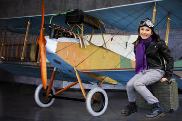 Plane, aviator- girl ready for travel around the world