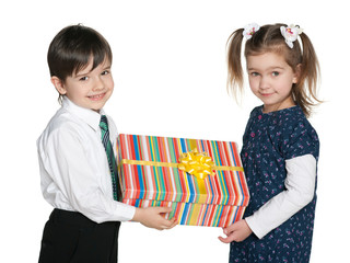 Happy children hold a gift box