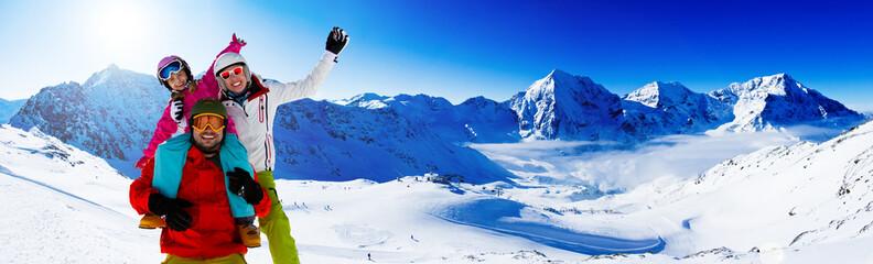 Skiing. Skiers enjoying winter vacation, panorama