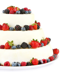 Beautiful wedding cake with berries, isolated on white