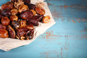 Tasty dates fruits on blue wooden table