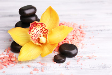 Colorful tropical orchid flowers and spa stones