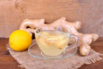 Cup of ginger drink and lemon
