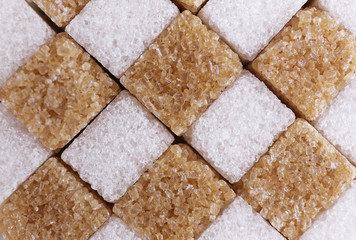 Brown and white refined sugar background
