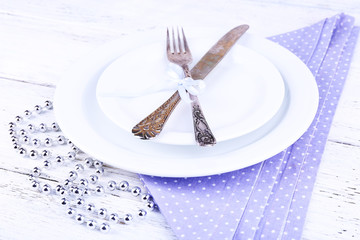 White plate, fork, knife and Christmas decoration