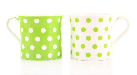 Polka dot mugs isolated on white