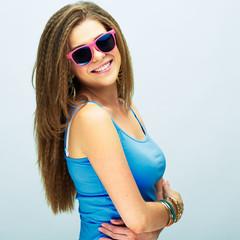 teeth smiling girl posing against white background
