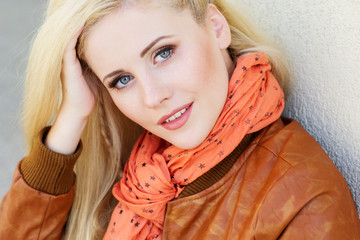 Nice blonde girl is wearing autumn clothes