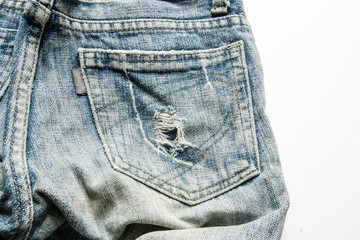 close up torn Blue jeans pocket in button position