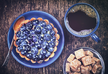 Blueberry tart and coffee