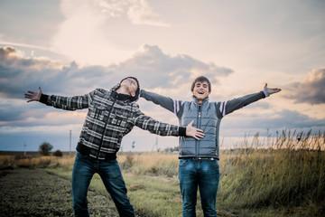 two happy teenagers outdoor