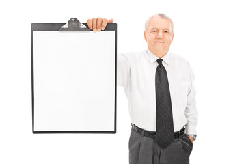 Mature businessman holding blank paper on clipboard