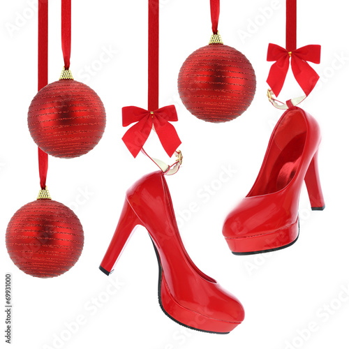 High heels shoes and Christmas balls hanging on red ribbon - 69931000