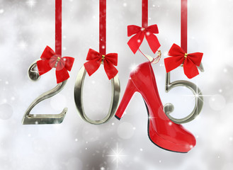 High heel shoe and 2015 number hanging on red ribbons