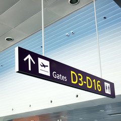 Gate A, B. Sign in airport. Interior of the airport.