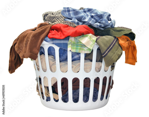 Pile of dirty laundry in a washing basket on white background - 69931838