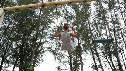 Serenity, Happiness and Freedom Concept. Girl on Swing. Slow