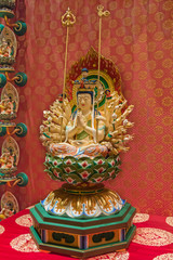 Buddha statuette with quantity arms and heads