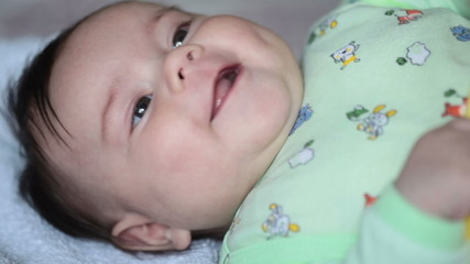 Close up of smiling baby's face. FullHD video