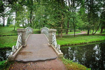 Old steel bridge over flow in the palace park in Gatchina