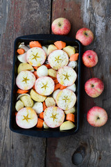 Apples with vegetables on a wooden background. Ingredients for r