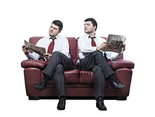 Two men on a red sofa