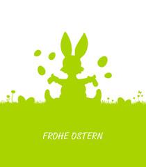 Osterhase sitzt in Wiese