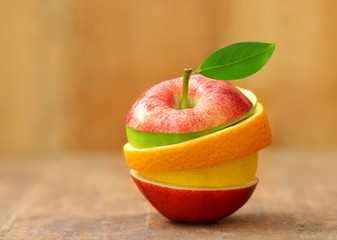 mixed fruit on wooden background.