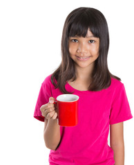 Young Asian preteen girl with a red mug over white background