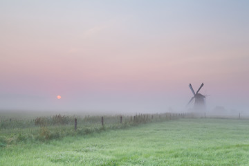 windmill and misty sunrise