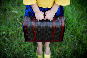 girl holding vintage suitcase, travel concept, change concept