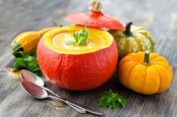 Cream pumpkin soup in a pumpkin