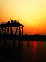 The silhouette of old wooden bridge kanchanaburi Thailand