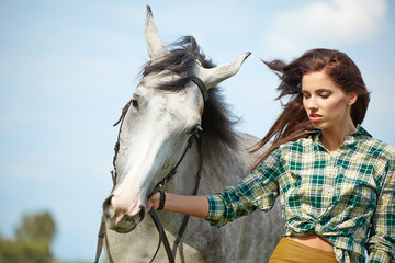 Woman with a white horse  outdoor