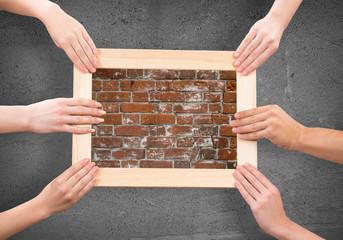 Hands holding frames