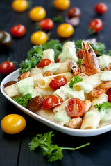 Pasta with shrimps and cherry