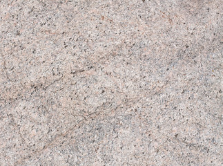Light brown motley stone texture.