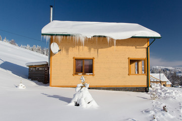 Small house in the snowy mountain