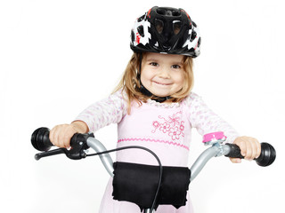 Cute girl is so proud on her bike