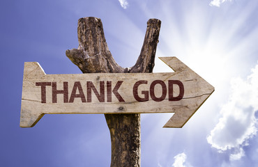 Thanks God wooden sign on a beautiful day