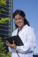 doctor female reading tablet