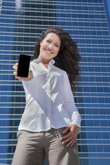 white shirt businesswoman showing mobile screen