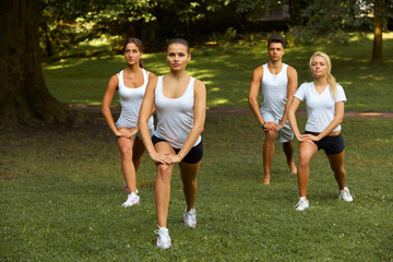 Fitness class. Portrait of smiling people doing power fitness ex