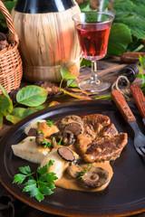 Steak with potato dumplings and forest mushroom sauce
